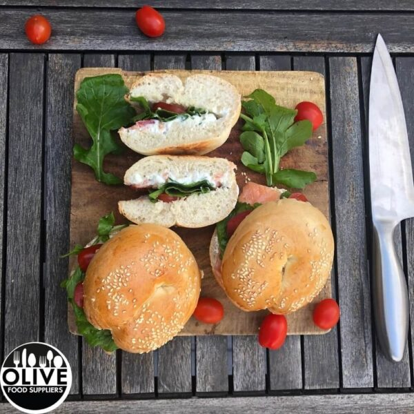 bagels on a cutting board on a outside table