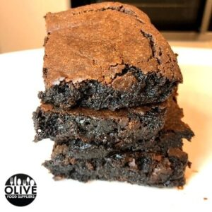 Sweet potato brownies stacked on a plate