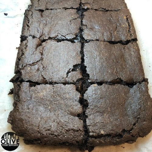 Fudgy sweet potato brownies cut into squares on baking paper